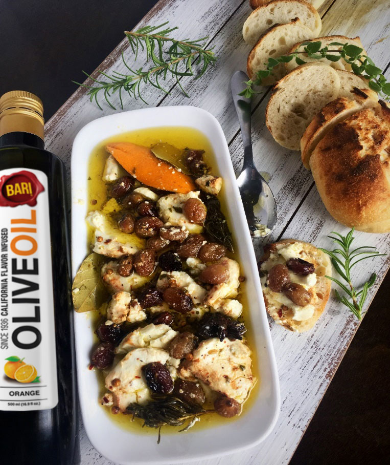 Marinated Goat Cheese with roasted grapes and Olive Oil